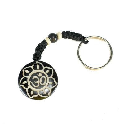 Přívěsek na klíče Om di bunga teratai hitam