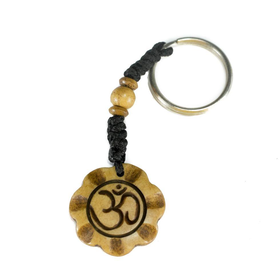 Kostěný přívěsek na klíče Om di mekar
